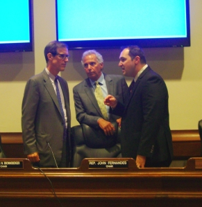 State Sen. William Brownsberger (left) and Rep. John Fernandes (center) confer during a Judiciary Committee hearing last June on H. 1459 and related bills. The Committee has subsequently taken no action on the bill.