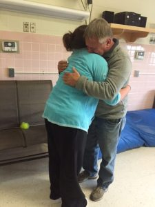 Chelsea and her father hug good-bye at Tewksbury State Hospital.